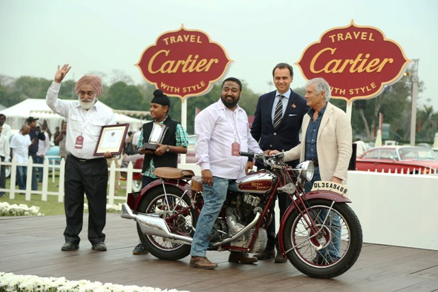 Mr Parvinder Singh owner of best of show motorcycle 1936 Royal Enfield 500, receiving trophy from Laurent Gaborit of Cartier and judge Giocomo Augustini, Best Motorcyle, Cartier Travel with Style 2015, Delhi