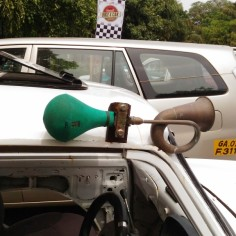 Vintage white fiat with local horn owned by Saby D'Souza at Goa's first Vintage Bike and Car rally 2016