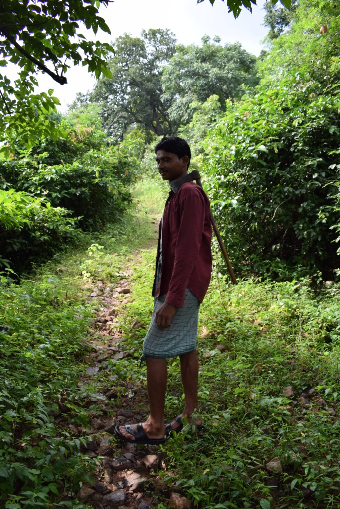 Krishna Kumar Nishad, a tribal,, guiding the way up to Singhnapur Caves, Raigarh, India