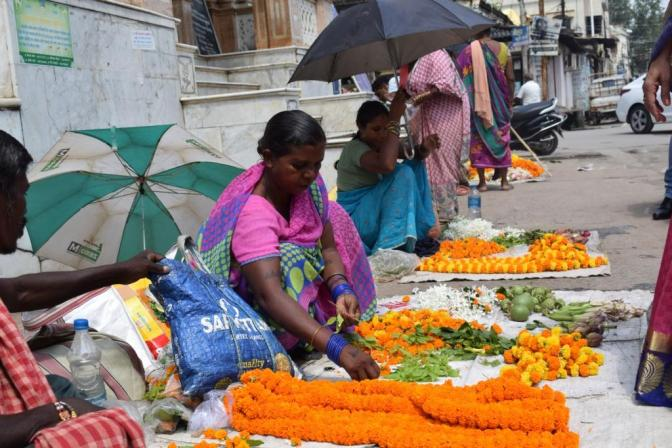 Selling flowers for puja, Gauri Shankar mandir, Raigarh, India