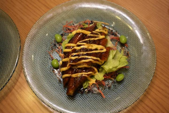 Unadon is a traditional Japanese donburi dish comprising barbecued eel on a bed of sushi rice.  Sakura, the Metropolitan hotel & Spa, New Delhi, india