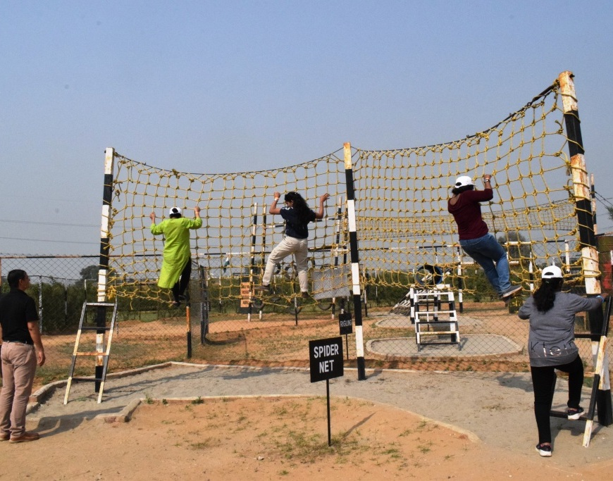 Women climb rope walls at Delta 105, Manesar, Gurgaon, Haryana, India