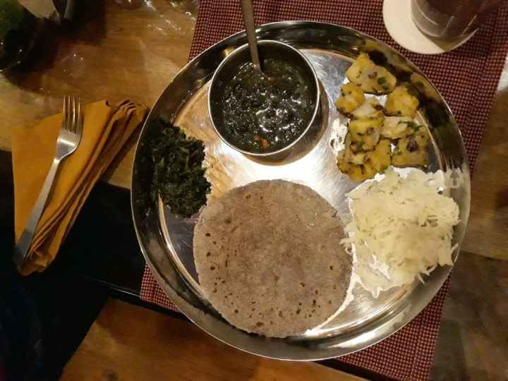 enjoy local cuisine, Kumaoni thali, at Corbett Wild Iris resort & Spa, Jim Corbett National Park, Uttarakhand, India