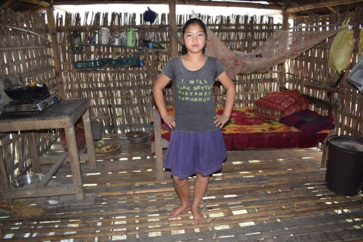 A young girl inside her home in Majuli, Assam, India